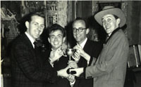 Burns Scandrett, Peter Evans, Watson Raines, and Clive celebrate at a New Zealand Magicians' Convention